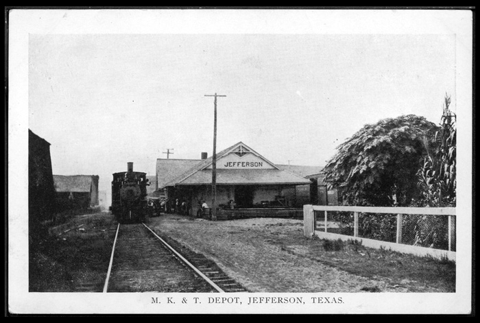 Missouri, Kansas and Texas Railway depot at Jefferson, Texas. locomotive and passengers visible.